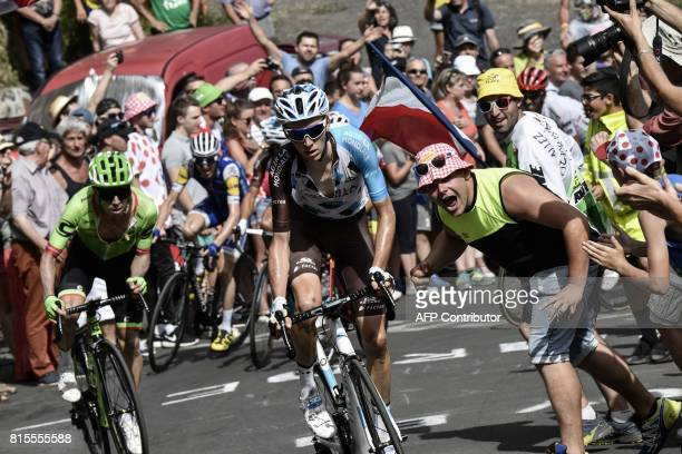 France's Romain Bardet and Colombia's Rigoberto Uran ride in a breakaway past supporters during the 1895 km fifteenth stage of the 104th edition of...