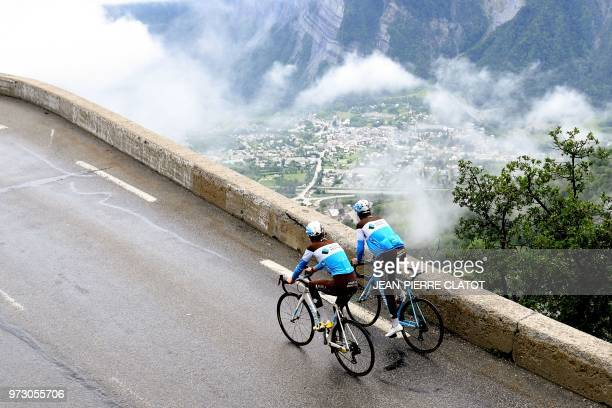 France's Romain Bardet and France's Tony Gallopin of France's AG2R cycling team ride during a track reconnaissance on the road towards the Alpe...