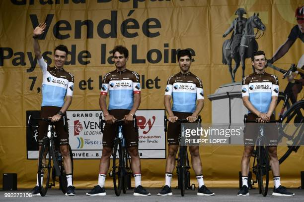 France's Romain Bardet and riders of France's AG2R La Mondiale cycling team stand on stage during the team presentation ceremony on July 5, 2018 in...