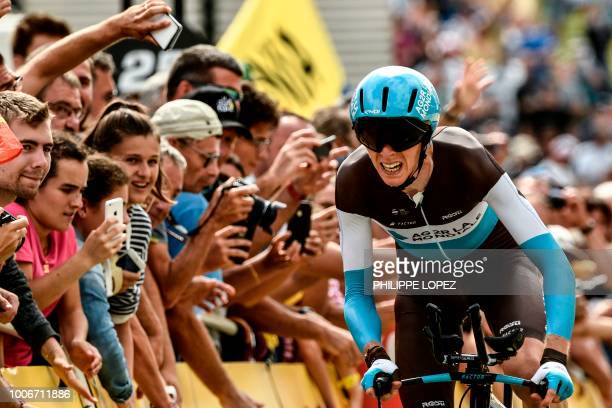 France's Romain Bardet crosses the finish line of the 20th stage of the 105th edition of the Tour de France cycling race, a 31-kilometer individual...