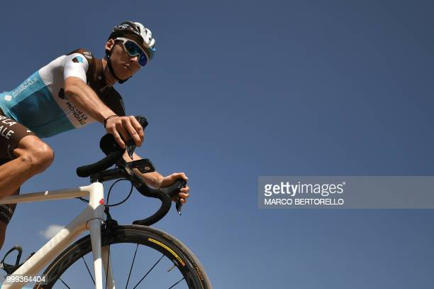 France's Romain Bardet cycles near the podium during the signing in ceremony prior to the start of the ninth stage of the 105th edition of the Tour...
