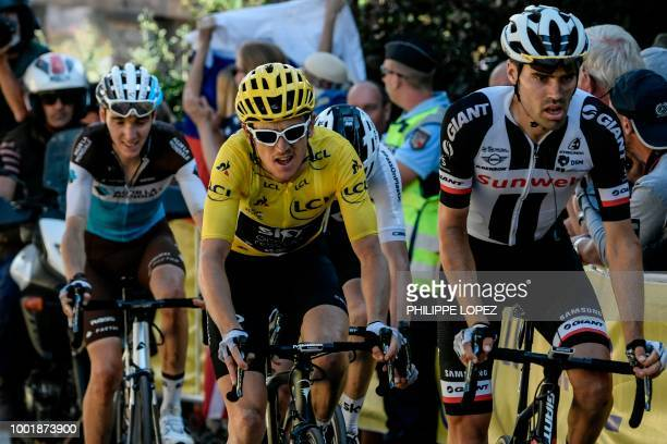 France's Romain Bardet Great Britain's Geraint Thomas Great Britain's Christopher Froome and Netherlands' Tom Dumoulin ride in the last kilometer...