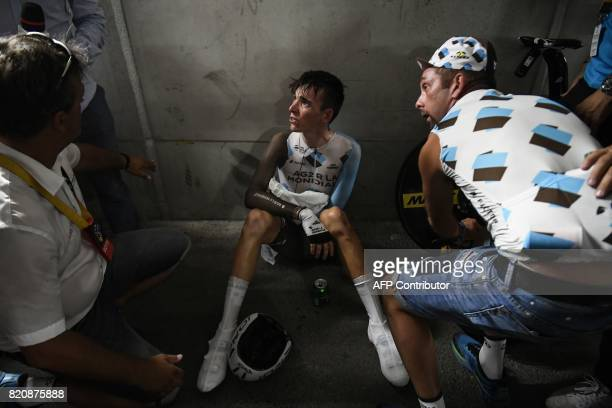 France's Romain Bardet reacts after crossing the finish line at the Velodrome stadium at the end of a 225 km individual timetrial the twentieth stage...