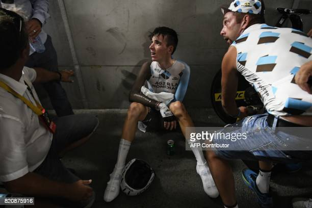 TOPSHOT France's Romain Bardet reacts after crossing the finish line at the Velodrome stadium at the end of a 225 km individual timetrial the...