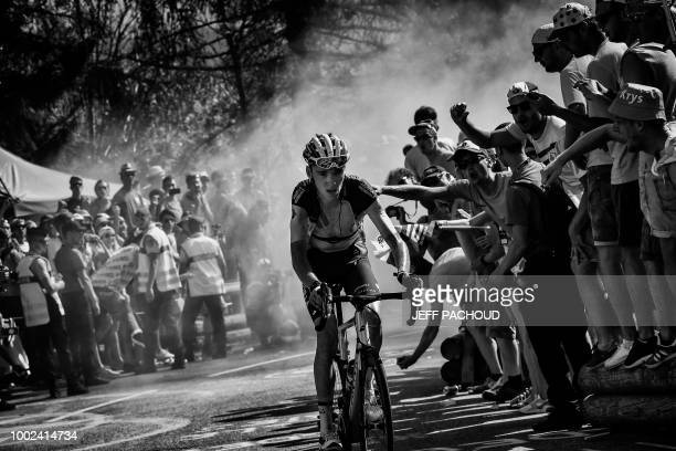 France's Romain Bardet rides through the socalled 'Dutch Corner' in the ascent to l'Alpe d'Huez during the twelfth stage of the 105th edition of the...