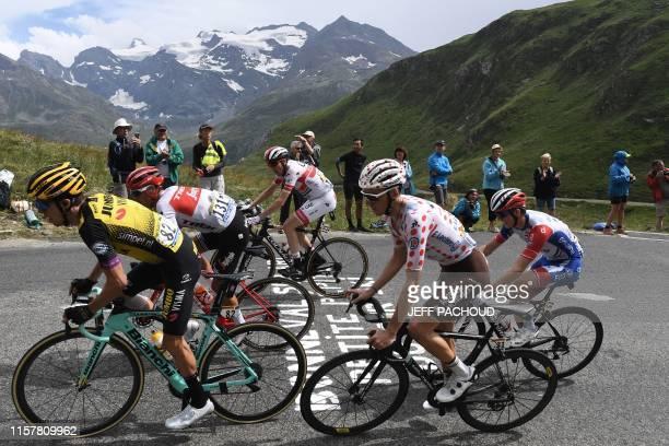 France's Romain Bardet , wearing the best climber's polka dot jersey, New Zealand's George Bennett , Australia's Richie Porte , Ireland's Daniel...
