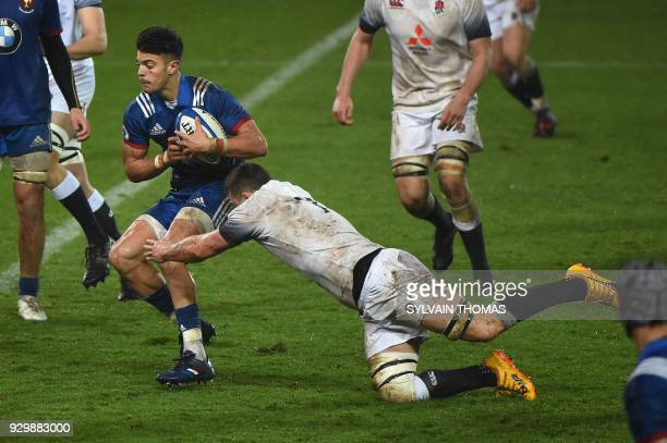 France's Romain Ntamack is tackled by England's Ben Earl during the Six Nations U20 rugby union match between France and England on March 9 2018 at...