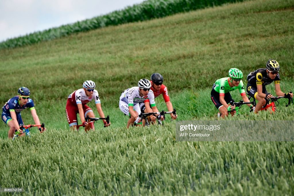 TOPSHOT - (From R) France's Romain Sicard, USA's Nathan Brown, Australia's Adam Hansen, France's Romain Hardy, Germany's Nils Politt and Belgium's Frederik Backaert ride in a breakaway during the 212,5 km third stage of the 104th edition of the Tour de France cycling race on July 3, 2017 between Verviers, Belgium and Longwy, France. /