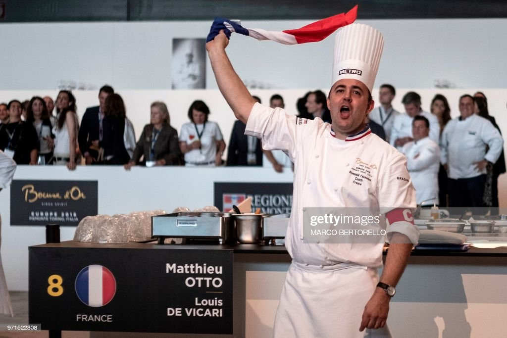 France's Romuald Fassenet waves a French flag during the Europe 2018 Bocuse d'Or International culinary competition on June 11, 2018 in Turin.