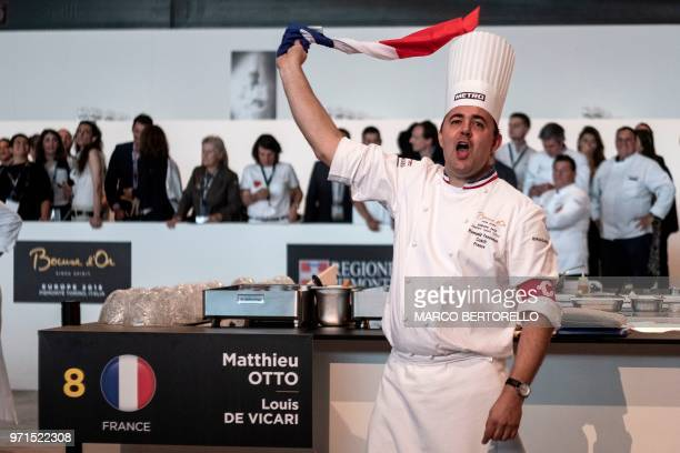France's Romuald Fassenet waves a French flag during the Europe 2018 Bocuse d'Or International culinary competition on June 11 2018 in Turin