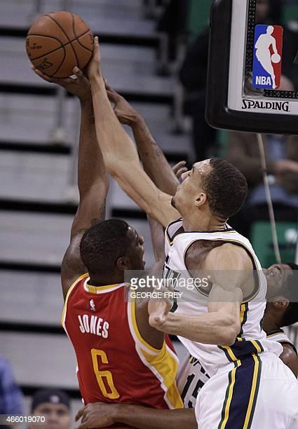 France's Rudy Gobert of the Utah Jazz blocks the shot of Terrence Jones of the Houston Rockets at the Energy Solutions Arena in Salt Lake City Utah...