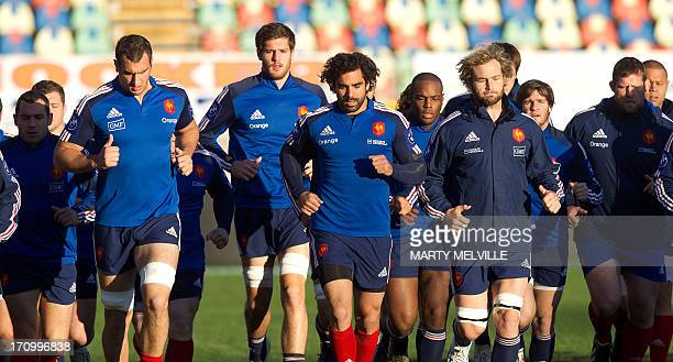 France's rugby players warmup during the captain's run ahead of the third rugby union test mach against the New Zealand All Blacks at Yarrow stadium...