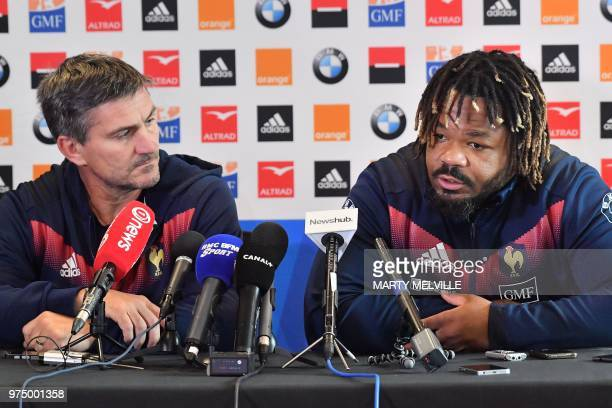 France's rugby team captain Mathieu Bastareaud and assistant coach Jean Marc Bederede attend a press conference at a hotel in Wellington on June 15...