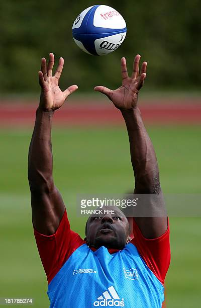 France's Rugby Union national team flanker Yannick Nyanga grabs the ball during a training session on September 25, 2013 in Marcoussis, outside...