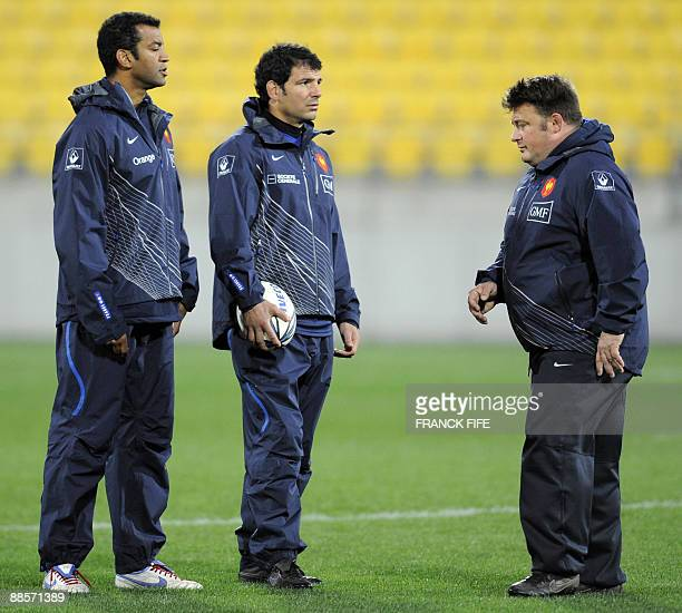 France's rugby union national team head coach Marc Lievremont chats with France's assistant coach for the backs Emile N'tamack and France's assistant...