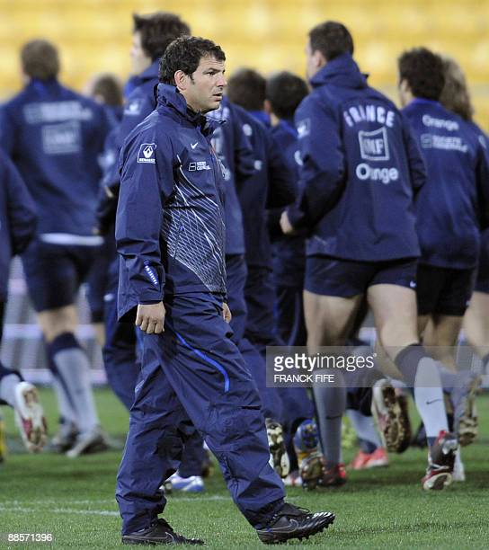 France's rugby union national team head coach Marc Lievremont looks on as his players jog during a training session at the Westpac Stadium in...
