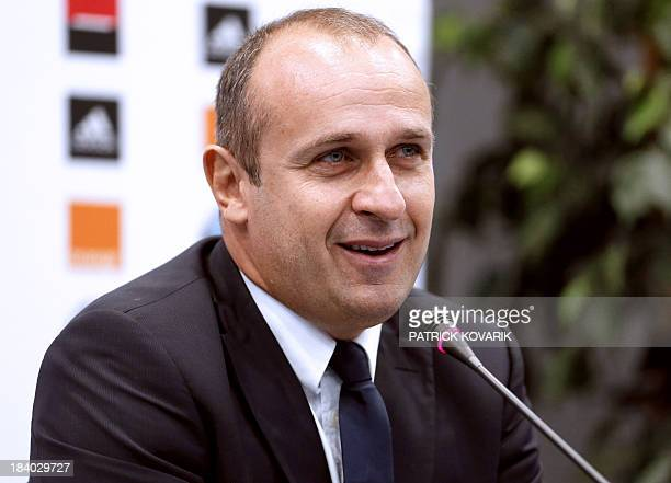 France's Rugby Union national team head coach Philippe Saint-Andre gives a press conference, on October 11, 2013 in Marcoussis, south of Paris, to...
