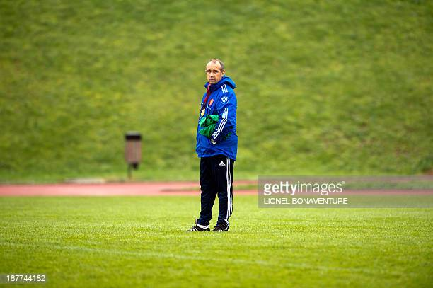 France's rugby union national team head coach Philippe Saint-Andre looks at his players during a training session as part of the team's preparation...