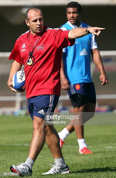 France's rugby union national team head's coach Philippe Saint Andre gestures during a training session, on September 24, 2013 in Marcoussis, outside...