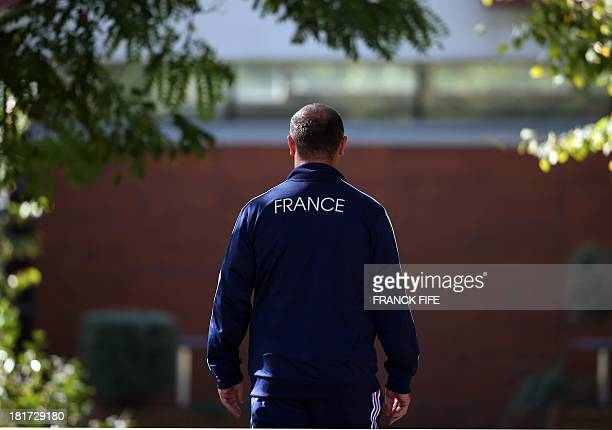 France's rugby union national team head's coach Philippe Saint Andre leaves the pitch after a training session, on September 24, 2013 in Marcoussis,...