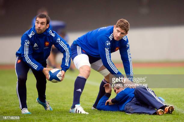 France's rugby union national team lock Pascal Pape and Frances scrum half Morgan Parra practice during a training session as part of the team's...