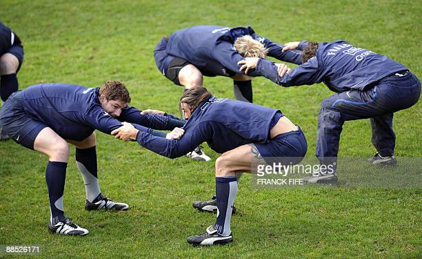 France's rugby union national team lock Sebastien Chabal stretches with teammates during a training session in Porirua on June 17 2009 France on June...