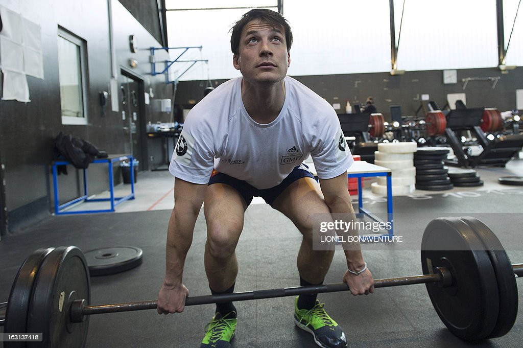 France's rugby union national team player Francois Trinh-Duc works out during an indoor training session on March 5, 2013 in Marcoussis, south of Paris, as part of the preparation for the Six Nations rugby union tournament. France will play Ireland in their 2013 Six nations rugby match on March 9, 2013.