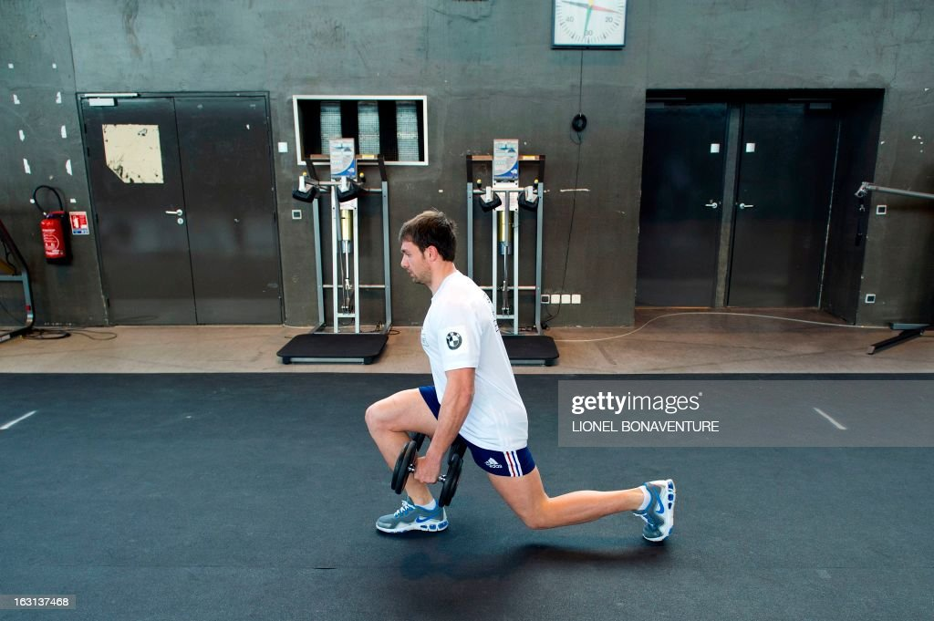 France's rugby union national team player Vincent Clerc warms up during an indoor training session on March 5, 2013 in Marcoussis, south of Paris, as part of the preparation for the Six Nations rugby union tournament. France will play Ireland in their 2013 Six nations rugby match on March 09, 2013.