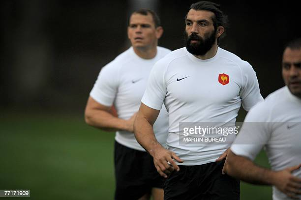 France's rugby union national team prop Pieter De Villiers lock Sebastien Chabal and prop captain Raphael Ibanez attend a training session 03 October...
