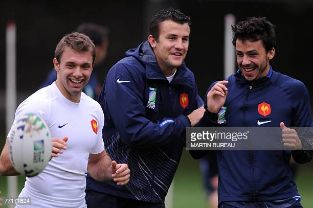 France's rugby union national team winger Vincent Clerc centre Damien Traille and fullback Clement Poitrenaud attend a training session 03 October...
