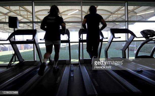 France's Rugby Union national team's hooker Dimitri Szarzewski and lock Lionel Nallet warm up during an indoor training session, on March 8, 2010 in...