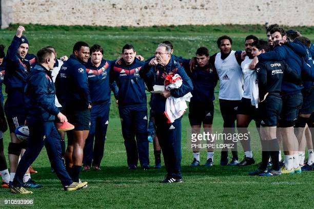 France's rugby union team coach Jacques Brunel talks to his players during a training session on January 26 2018 at the team's training camp in...