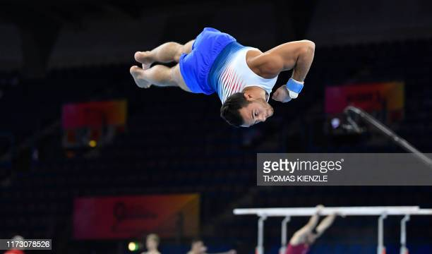 France's Samir Ait Said flips in the air as he performs on the floor during a training session for the FIG Artistic Gymnastics World Championships in...