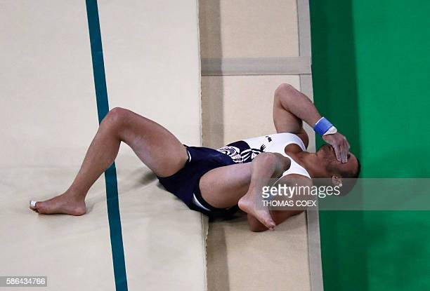 TOPSHOT France's Samir Ait Said reacts after injuring his leg while competing in the qualifying for the men's vault event of the Artistic Gymnastics...
