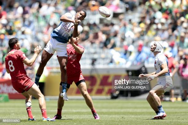 France's Samuel Alerte jumps to grab the ball during the second day of the World Rugby Sevens Series match between France and Canada at Cape Town...