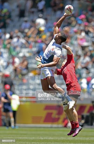 France's Samuel Alerte reaches for the ball during the second day of the World Rugby Sevens Series match between France and Canada at Cape Town...