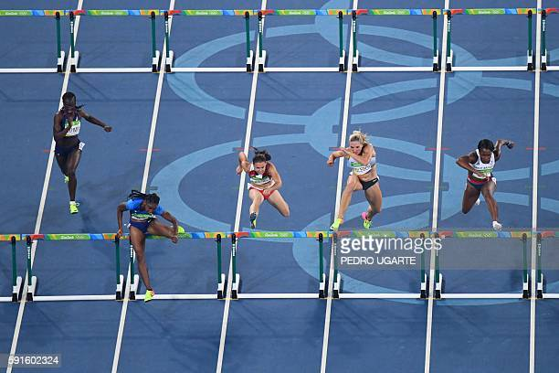France's Sandra Gomis USA's Brianna Rollins Belarus' Alina Talay Germany's Cindy Roleder and Britain's Tiffany Porter compete in the Women's 100m...