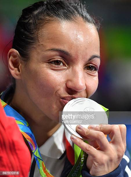 France's Sarah Ourahmoune poses on the podium with a silver medal during the Rio 2016 Olympic Games at the Riocentro Pavilion 6 in Rio de Janeiro on...