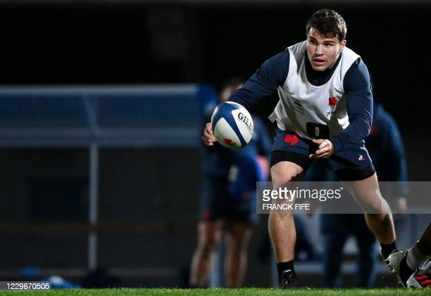 France's scrum half Antoine Dupont clears a ball during a training session on November 18, 2020 in Marcoussis, south of Paris, as part of the...