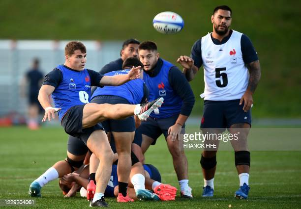 France's scrum half Antoine Dupont kicks the ball during a training session on October 21 2020 in Marcoussis south of Paris as part of the...