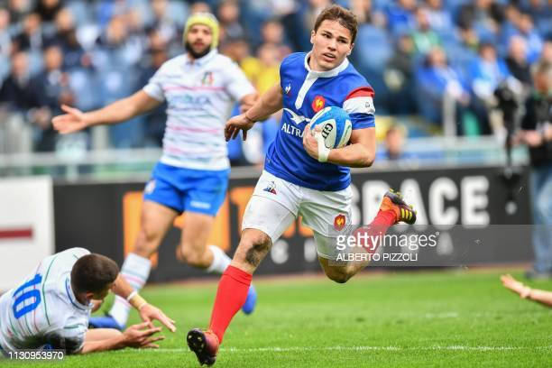 France's scrum half Antoine Dupont runs on his way to score a try during the Six Nations international rugby union match Italy vs France on March 16...