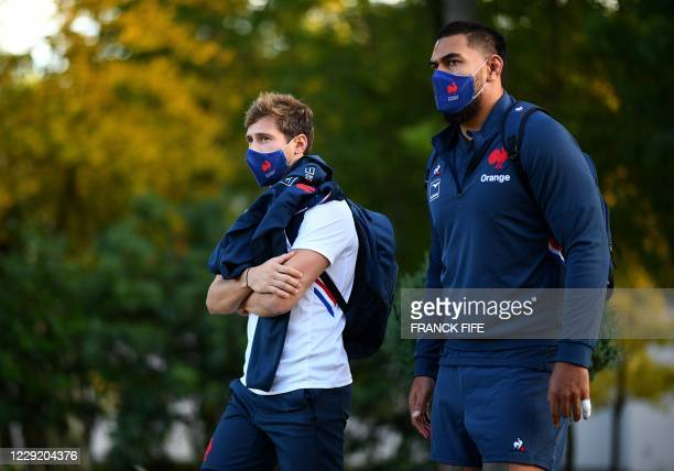 France's scrum half Baptiste Serin and France's lock Romain Taofifenua arrive for a training session on October 21 2020 in Marcoussis south of Paris...