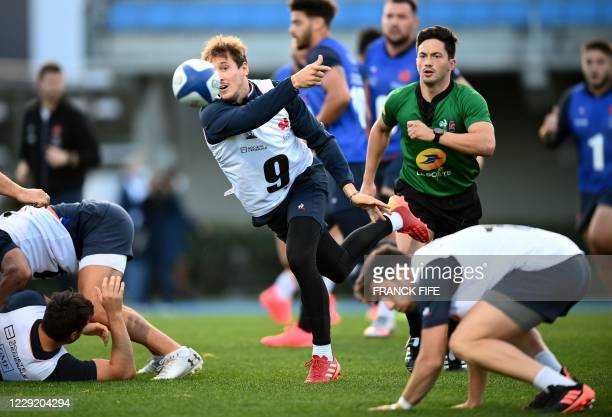 France's scrum half Baptiste Serin passes the ball during a training session on October 21 2020 in Marcoussis south of Paris as part of the...