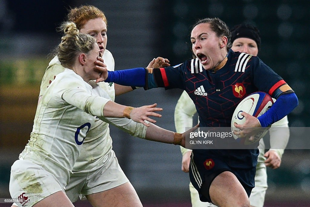 TOPSHOT - France's scrum half Jade Le Pesq (R) hands-off England's scrum-half Natasha Hunt (L) during the Six Nations international women's rugby union match between England Women and France Women at Twickenham stadium in south west London on February 4, 2017. / AFP PHOTO / Glyn KIRK