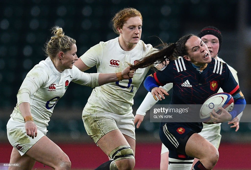 TOPSHOT - France's scrum half Jade Le Pesq (R) has her hair pulled by England's scrum-half Natasha Hunt (L) during the Six Nations international women's rugby union match between England Women and France Women at Twickenham stadium in south west London on February 4, 2017. / AFP PHOTO / Glyn KIRK
