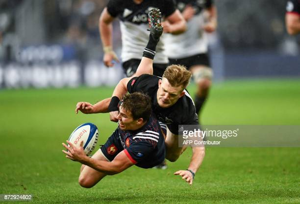 TOPSHOT France's scrumhalf Antoine Dupont is tackled by New Zealand's fullback Damian McKenzie during the friendly rugby union international Test...