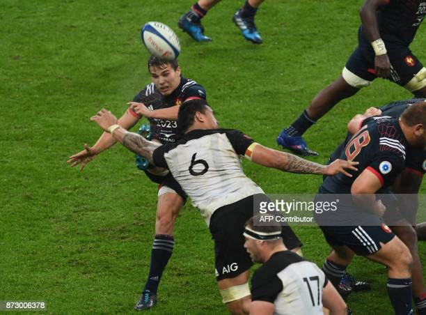 France's scrumhalf Antoine Dupont kicks past New Zealand's flanker Vaea Fifita during the friendly rugby union international Test match between...