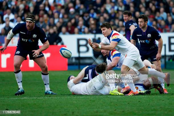France's scrumhalf Antoine Dupont passes the ball during the Six Nations rugby union tournament match between France and Scotland at the Stade de...