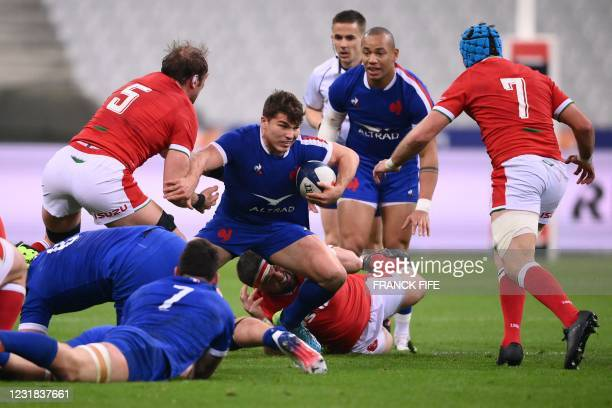 France's scrum-half Antoine Dupont runs to evade Wales' lock Alun Wyn Jones during the Six Nations rugby union tournament match between France and...