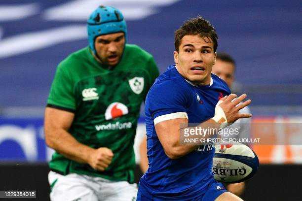 France's scrum-half Antoine Dupont runs with the ball to score a try during the Six Nations rugby union tournament match between France and Ireland...